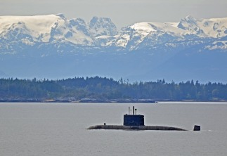 HMCS Victoria, with Texada Island and the Comox glacier in the background.
