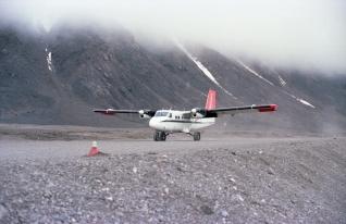 Kenn Borak twin otter landing at Grise Fiord, 1979